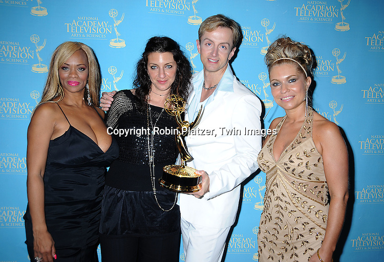 As The World Turns Makeup winners form left to right..Stephanie Glover-McGee, Kimberly Braisin, Eldo Ray Estes and Anette Lian-Williams..posing for photographers at The 35th Annual Creative Arts & Entertainment Daytime Emmy Awards on June 13, 2008 at Rose Hall in Lincoln Center in New York City.....Robin Platzer, Twin Images