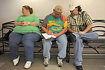 (L-r) Connie Fuller, 39, waits as the witness while Rock Island, Illinois couple Curtis Harris, 50, and Daren Adkisson, 39, fill out their marriage license first thing in the morning the first day same sex weddings are legal across Iowa at the Scott County Recorder's Office in Davenport, Iowa on April 27, 2009.
