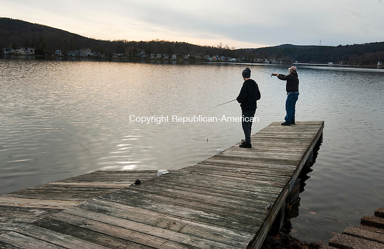 WINSTED, CT--- -122515JS03--Joey Takeman, 16, left, and Jay Takeman, take advantage of the unseasonably warm temperatures and get in some fishing at Highland Lake in Winsted on Friday. Temperatures were in the high 50's to low 60's on Christmas Day. Joey Takeman was named Connecticut Youth Male Angler of the Year Award by the state Department of Energy and Environmental Protection. <br /> Jim Shannon Republican-American