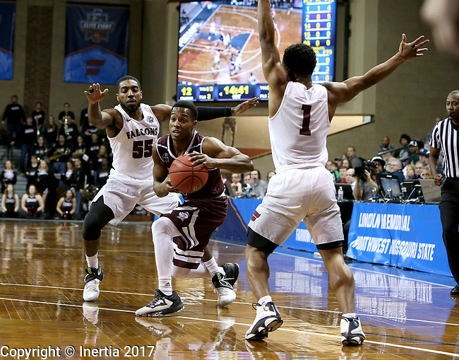 SIOUX FALLS, SD: MARCH 23: Al Davis #3 from Bellarmine tries to split the defense of Shammgod Wells #55 and Jason Jolly #1 from Fairmont State during the Men's Division II Basketball Championship Tournament on March 23, 2017 at the Sanford Pentagon in Sioux Falls, SD. (Photo by Dave Eggen/Inertia)