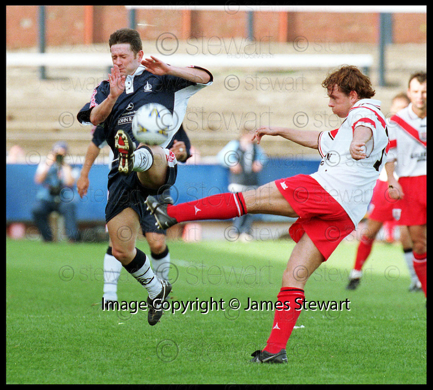 19th September 98      .Copyright Pic : James Stewart   .FALKIRK V AIRDRIE.TONY SMITH CLEARS FROM KEVIN MCALLISTER.......Payments to :-.James Stewart Photo Agency, Stewart House, Stewart Road, Falkirk. FK2 7AS      Vat Reg No. 607 6932 25.Office : 01324 630007        Mobile : 0421 416997.If you require further information then contact Jim Stewart on any of the numbers above.........