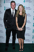 PACIFIC PALISADES, CA - NOVEMBER 06: Eric Dane, Rebecca Gayheart at Healthy Child Healthy World's Mom On A Mission Awards & Gala on November 6, 2013 in Pacific Palisades, California. (Photo by David Acosta/Celebrity Monitor)