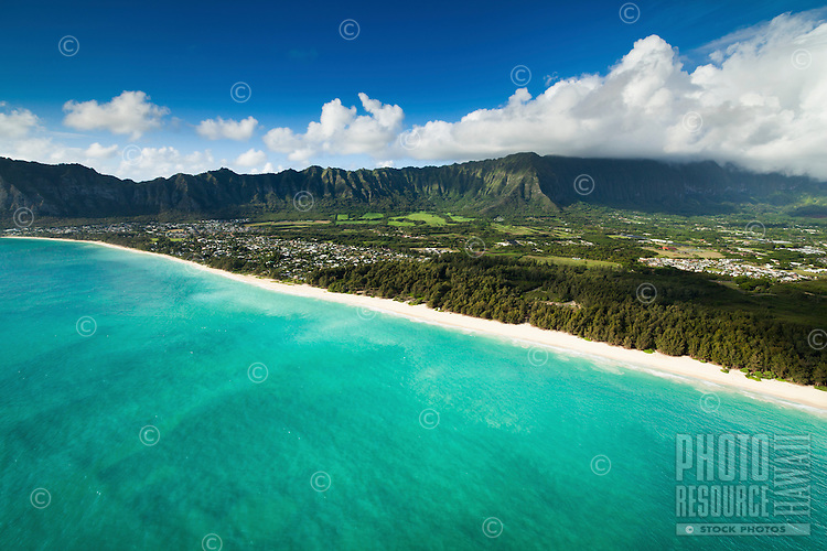 An aerial view of Waimanalo Beach at sunrise, with the Ko'olau Range in the distance.