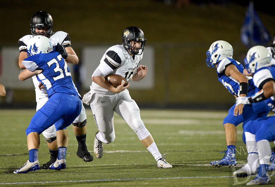 NWA Democrat-Gazette/BEN GOFF @NWABENGOFF<br /> Kasey Ford, Bentonville quarterback, runs the ball in the first quarter on Friday Oct. 23, 2015 during the game against Rogers in Whitey Smith Stadium in Rogers.