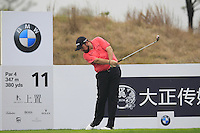 Shane Lowry (IRL) tees off the 11th tee during Friday's Round 2 of the 2014 BMW Masters held at Lake Malaren, Shanghai, China 31st October 2014.<br /> Picture: Eoin Clarke www.golffile.ie
