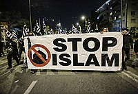 "Members of far right group Golden Dawn (Chrysi Avgi) march with a banner ""Stop Islam"""