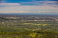 Aerial view of the city of Fairbanks and the Alaska range mountains on the distant horizon.