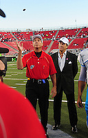 Oct. 8, 2009; Las Vegas, NV, USA; California Redwoods owner Paul Pelosi (right) looks on as referee Jon Bible does the first coin toss in league history prior to the game against the Las Vegas Locomotives during the inaugural United Football League game at Sam Boyd Stadium. Mandatory Credit: Mark J. Rebilas-
