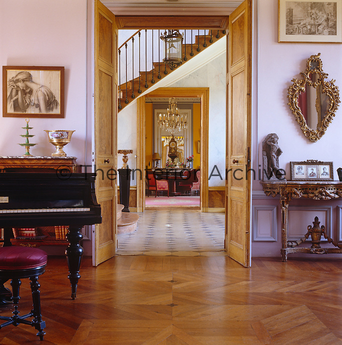 Enfilade through the open doors of the Music Room, across the Entrance Hall and into the Grand Salon
