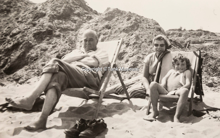 BNPS.co.uk (01202 558833)<br /> Pic: TankMuseum/BNPS<br /> <br /> Harold Mortimore and daughter Tilly on holiday in 1954 (possibly Norfolk) the other person is the family's German  au pair Marta.I<br /> <br /> The first man ever to command a tank in battle only volunteered for the secret mission because learning to fly aeroplanes was so terrifying, his daughter has revealed.<br /> <br /> Captain Harold 'Morty' Mortimore commanded tank 'D1' on September 15, 1916, at The Somme in World War One.<br /> <br /> Capt Mortimore had previously crashed an aeroplane while training with the Royal Naval Air Service and was subsequently looking to keep his feet on the ground. <br /> <br /> When volunteers were asked to join a top secret mission he put his hand up immediately. <br /> <br /> A few months later the moustachioed pioneer was rolling over no man's land towards the German trenches in the first tank to ever engage an enemy.