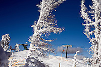 Skiers ride a chairlift at Showdown Ski Area on King's Hill in the Little Belt Mountains near Neihart, Montana, USA.