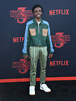 "28 June 2019 - Santa Monica, California - Caleb McLaughlin. ""Stranger Things 3"" Los Angeles Premiere held at Santa Monica High School. Photo Credit: Birdie Thompson/AdMedia"