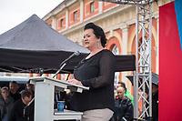 """AfD-Kundgebung in Potsdam.<br /> Ca. 70 AfD-Anhaenger kamen am Samstag den 9. September 2017 zu einer Wahlveranstaltung der rechtsnationalistischen """"Alternative fuer Deutschland"""", AfD. Unter den Teilnehmern waren u.a. Neonazis die """"Patrioten Cottbus"""" oder die sog. """"Schwarze Sonne"""", ein Zeichen der SS auf ihren Jacken trugen. Offiziell hatte die AfD die Kundgebung als Gruendung einer rechten Gewerkschaft namens """"Alternativer Arbeitnehmerverband Mitteldeutschland"""" (Alarm) in Brandenburg deklariert.<br /> 500 Menschen protestierten friedlich gegen die Veranstaltung.<br />  Im Bild: Birgit Bessin aus Worms, stellvertretende Landesvorsitzende der AfD-Brandenburg. <br /> 9.9.2017, Potsdam<br /> Copyright: Christian-Ditsch.de<br /> [Inhaltsveraendernde Manipulation des Fotos nur nach ausdruecklicher Genehmigung des Fotografen. Vereinbarungen ueber Abtretung von Persoenlichkeitsrechten/Model Release der abgebildeten Person/Personen liegen nicht vor. NO MODEL RELEASE! Nur fuer Redaktionelle Zwecke. Don't publish without copyright Christian-Ditsch.de, Veroeffentlichung nur mit Fotografennennung, sowie gegen Honorar, MwSt. und Beleg. Konto: I N G - D i B a, IBAN DE58500105175400192269, BIC INGDDEFFXXX, Kontakt: post@christian-ditsch.de<br /> Bei der Bearbeitung der Dateiinformationen darf die Urheberkennzeichnung in den EXIF- und  IPTC-Daten nicht entfernt werden, diese sind in digitalen Medien nach §95c UrhG rechtlich geschuetzt. Der Urhebervermerk wird gemaess §13 UrhG verlangt.]"""