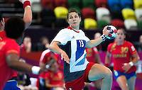 25 JUL 2012 - LONDON, GBR - Yvonne Leuthold (GBR) of Great Britain (centre) shoots during the women's London 2012 Olympic Games warm up handball match against Spain at The Copper Box in the Olympic Park, in Stratford, London, Great Britain .(PHOTO (C) 2012 NIGEL FARROW)