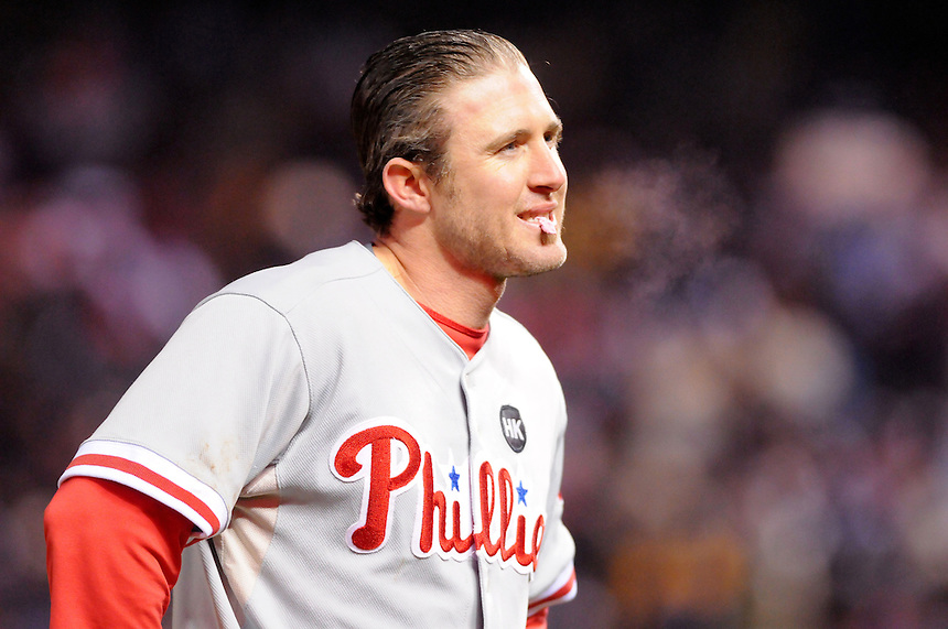 11 October 2009: Phillies 2nd baseman Chase Utley can see his breath during a National League Division Series game between the Philadelphia Phillies and the Colorado Rockies at Coors Field in Denver, Colorado. The Phillies beat the Rockies 6-5 as the temperature dipped into the 20's. *****For editorial use only*****