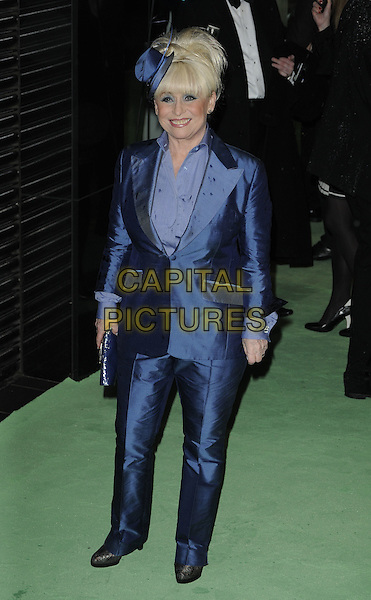 BARBARA WINDSOR.Royal World Film Premiere of 'Alice in Wonderland' at the Odeon Cinema, Leicester Square, London, England..February 25th, 2010 .arrivals full length blue hat shirt fascinator suit trousers jacket clutch bag silk .CAP/CAN.©Can Nguyen/Capital Pictures.