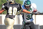 Palos Verdes, CA 10/08/10 - Dylan Redondo  (South #33) and Jin Matsumoto (Peninsula #40) in action during the South Torrance Spartans vs Peninsula Panthers Varsity football game at Palos Verdes Peninsula High School.