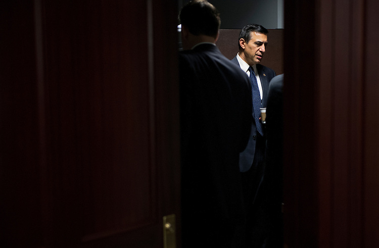 UNITED STATES - SEPTEMBER 26: Rep. Darrell Issa, R-Calif., talks with a colleague during a meeting of the Republican caucus in the Capitol. (Photo By Tom Williams/CQ Roll Call)