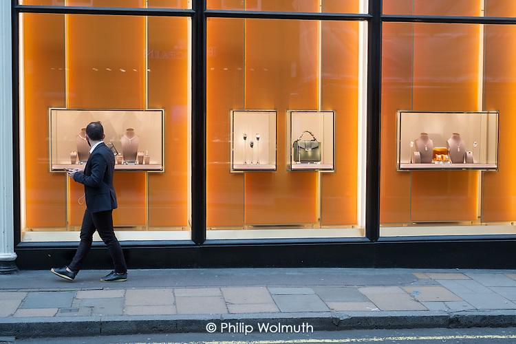 Window shopper outside Bulgari luxury goods shop, Mayfair, London.
