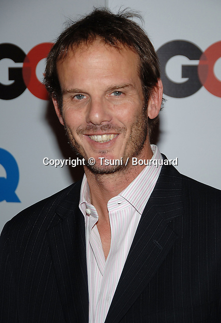 Peter Berg arriving at the 2006 GQ - Men Of The Year  at the Sunset Tower in Los Angeles.<br /> <br /> headshot<br /> smile<br /> eye contact