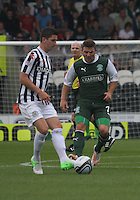 Kenny McLean closed down by Gary Deegan in the St Mirren v Hibernian Clydesdale Bank Scottish Premier League match played at St Mirren Park, Paisley on 18.8.12.