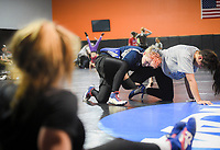 NWA Democrat-Gazette/CHARLIE KAIJO Suravieve Robertson, 15, of Searcy (second from right) and Aliana Barnoski, 16, of Broken Arrow, OK. (right) wrestle during a women's wrestling camp, Monday, June 3, 2019 at the Honey Badger Wrestling Club in Bentonville<br />