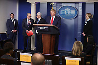 United States President Donald J. Trump speaks during a press conference with members of the coronavirus task force in the Brady Press Briefing Room of the White House on March 24, 2020 in Washington, DC.  On the podium behind the President, from left to right: Director of the National Economic Council Larry Kudlow; US Vice President Mike Pence; and Dr. Deborah L. Birx, White House Coronavirus Response Coordinator.<br /> Credit: Oliver Contreras / Pool via CNP/AdMedia
