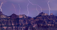 935000011 panoramic view -  powerful lightning bolts strikes near wotans throne and zoster temple on the north rim of grand canyon national park in arizona