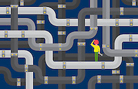 Confused woman holding spanner looking at tangled network of pipes