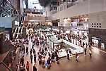 Kyoto Station building interior busy with people in the evening, second largest train station building in Japan. Shimogyo-ku, Kyoto, Japan 2017.