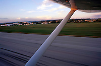 Wing of a private plane landing at the airport in Les Milles, France.