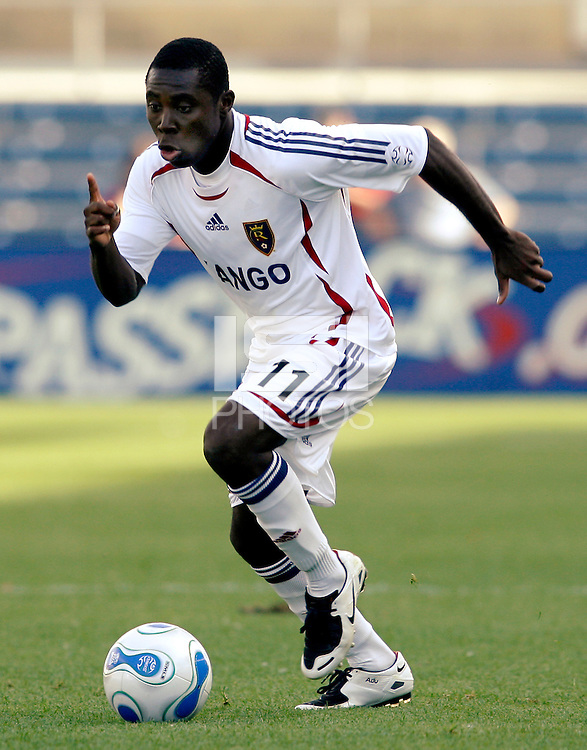 Real Salt Lake midfielder Freddy Adu (11) dribbles the ball.  The Chicago Fire and Real Salt Lake tied 0-0 at Toyota Park in Bridgeview, IL on May 27, 2007.