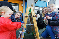 Pictured: Two toddlers use brushes to paint on paper. Thursday 21 March 2019<br /> Re: Julie Morgan, AM, has met parents at Twinkle Star playgroup before new legislation is brought in by the Welsh Government to ban parents from smacking children, Cardiff, Wales, UK.