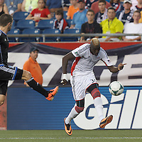 New England Revolution forward Saer Sene (39) crosses the ball.  In a Major League Soccer (MLS) match, the New England Revolution (white) defeated San Jose Earthquakes (black), 2-0, at Gillette Stadium on July 6, 2013.
