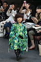 Petite artist Hitomi Goto poses on the catwalk wearing clothes from the tenbo 2016 Spring-Summer Collection during the Mercedes-Benz Fashion Week Tokyo, in Roppongi on October 13, 2015, Tokyo, Japan. tenbo invited people with disabilities to join models and celebrities on the runway in a message of peace. The Mercedes-Benz Fashion Week Tokyo runs from October 12 to 17. (Photo by Rodrigo Reyes Marin/AFLO)