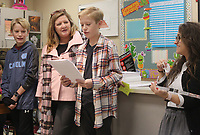 NWA Democrat-Gazette/DAVID GOTTSCHALK Elizabeth Brown (from right), with Walmart Logistics, watches Wednesday, January 10, 2018, as Wesley Marsh, a sixth grade student at Holt Middle School, reads an essay after he was recognized by Debbie Hodges, Walmart Logistics, along with his twin brother David as the 2018 Dr. Martin Luther King Jr. Dream Award Winners for Fayetteville Schools. The essay contest is for sixth grade students. Winning essays were selected from the Bentonville, Rogers, Springdale and Fayetteville School Districts. The winning students receive a variety of prizes, a cash donation to their schools and the opportunity to participate in the Dr. Martin Luther King Jr. recognition and celebration event at the Walmart Home Office Monday in Bentonville.