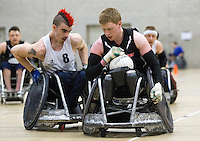27 MAY 2013 - DONCASTER, GBR - Jim Roberts (right) of West Coast Crash races to the goal line, pursued by David Anthony (left) of the South Wales Pirates, during the 2013 Great Britain Wheelchair Rugby Nationals bronze medal match at The Dome in Doncaster, South Yorkshire (PHOTO (C) 2013 NIGEL FARROW)