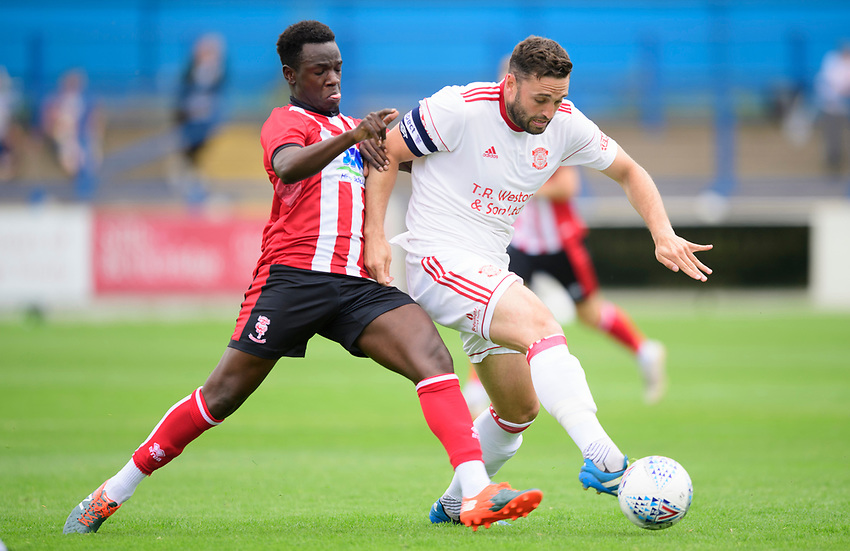 Lincoln City's trialist vies for possession with Lincoln United's Matt Wilson<br /> <br /> Photographer Chris Vaughan/CameraSport<br /> <br /> Football Pre-Season Friendly (Community Festival of Lincolnshire) - Lincoln City v Lincoln United - Saturday 6th July 2019 - The Martin & Co Arena - Gainsborough<br /> <br /> World Copyright © 2018 CameraSport. All rights reserved. 43 Linden Ave. Countesthorpe. Leicester. England. LE8 5PG - Tel: +44 (0) 116 277 4147 - admin@camerasport.com - www.camerasport.com