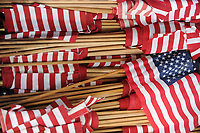 NWA Democrat-Gazette/ANDY SHUPE<br /> Residents place flags at each marker Saturday, May 27, 2017, at the Fayetteville National Cemetery as a part of the cemetery's annual observance of Memorial Day. Gov. Asa Hutchinson will speak in honor of the cemetery's 150th Anniversary at 10 a.m. Monday during the facility's annual Memorial Day observance.