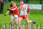 An Ghaeltacht's Cathal O Luing gets his pass away against East Kerry's Dara Roche in the minor County championship final at Killorglin on Saturday.