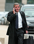 Bruce Lindsey, former Clinton Administration official, speaks on his cell phone as he departs United States District Court in Washington, D.C. on January 11, 2005.  <br /> Credit: Ron Sachs / CNP<br /> <br /> (RESTRICTION: NO New York or New Jersey Newspapers or newspapers within a 75 mile radius of New York City)