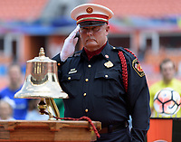 Houston, TX - Saturday May 27, 2017: First Responder honoring fallen comrades during a regular season National Women's Soccer League (NWSL) match between the Houston Dash and the Seattle Reign FC at BBVA Compass Stadium.