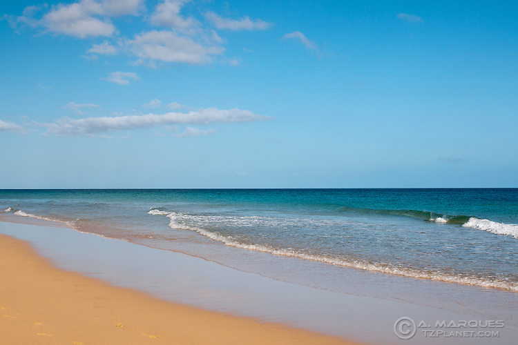 View of Matorral Beach (Playa de Matorral), Fuerteventura, Canary Islands, Spain. <br /> Empty beach on the south coast of Fuerteventura. <br /> The different tone of blue contrast with the golden sand.