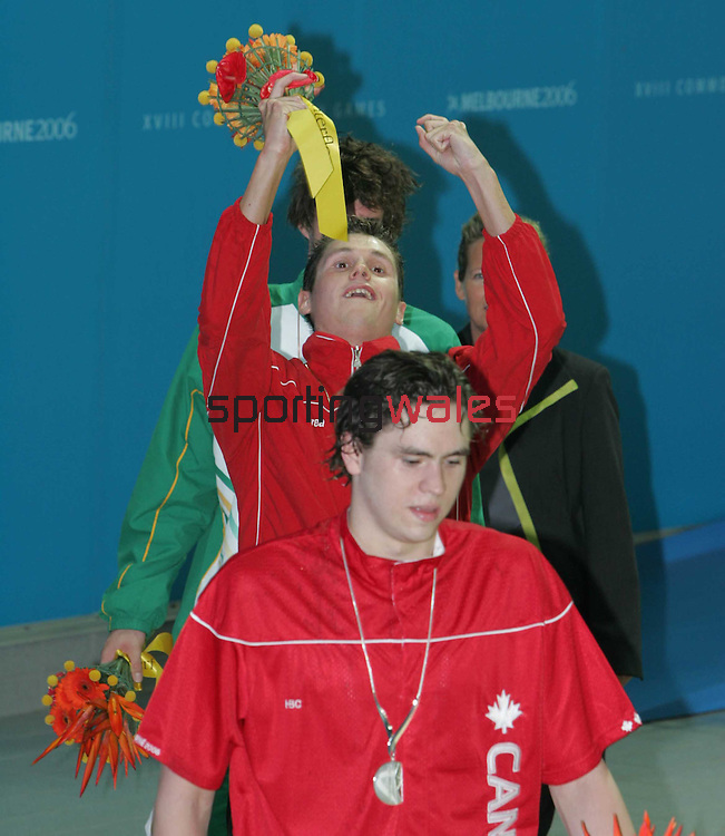 David Davies starts his celebration after taking gold Men's 1500m Freestyle..Commonwealth Games Swimming.Melbourne Aquatic Centre.Melbourne.21.03.06.©Steve Pope.Steve Pope Photography.The Manor .Coldra Woods.Newport.South Wales.NP18 1HQ.07798 830089.01633 410450.steve@sportingwales.com.
