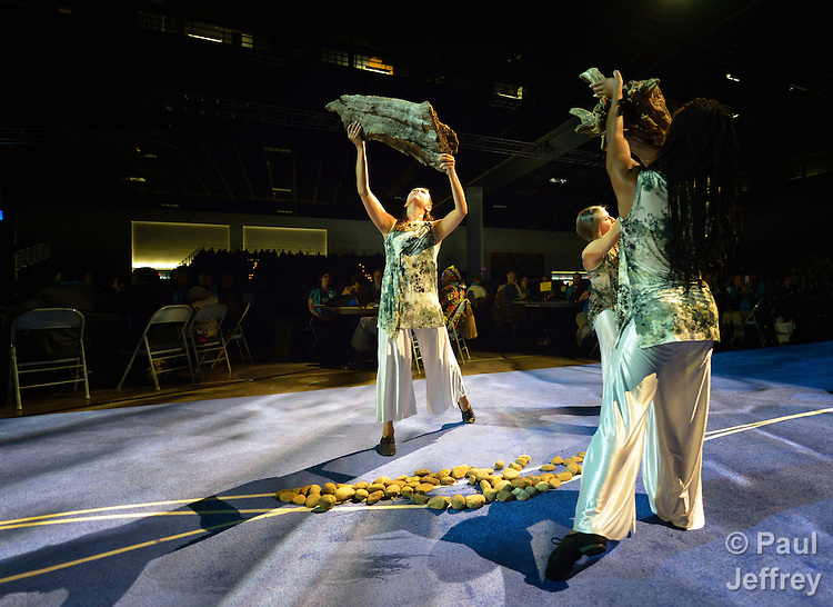 Liturgical dancers participate in the April 24 opening worship service of the 2012 United Methodist General Conference in Tampa, Florida. They are picking up pieces of driftwood, symbolic of the seaside setting for the quadrennial legislative assembly.