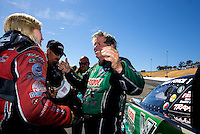 Jul. 27, 2014; Sonoma, CA, USA; NHRA funny car driver Courtney Force (left) is congratulated by father John Force after winning the Sonoma Nationals at Sonoma Raceway. Mandatory Credit: Mark J. Rebilas-