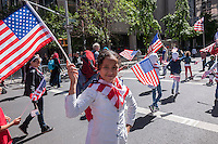 "Muslims from the tri-state area gather on Madison Avenue  in New York on Sunday, September 14, 2014 for the American Muslim Parade. The annual parade, now in it's 29th year, celebrates the diversity and heritage of Islamic culture. Participants march down Madison Avenue ending in a street fair. This year's theme is ""Islam and America Share Common Values."" (© Richard B. Levine)"