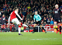 Mesut Ozil of Arsenal shoots on goal during the Premier League match between Arsenal and Huddersfield Town at the Emirates Stadium, London, England on 29 November 2017. Photo by Carlton Myrie / PRiME Media Images.