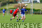 Daragh O'Connor Laune Rangers is tracked by Pa Kilkenny Glenbeigh/Glencar during the Mid Kerry final in Killorglin on Sunday