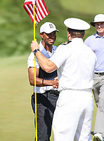 Potomac, MD - June 30, 2018: Tiger Woods (USA) shakes a service man hand during Round 3 at the Quicken Loans National Tournament at TPC Potomac in Potomac, MD, June 30, 2018.  (Photo by Elliott Brown/Media Images International)